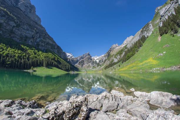 Lake Seealpsee with mountain Säntis Appenzell Alps Switzerland stock photo