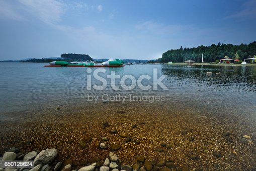 istock lake shore with pebbles and clear water 650125624
