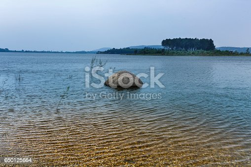 istock lake shore with pebbles and clear water 650125664