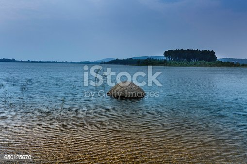 istock lake shore with pebbles and clear water 650125670