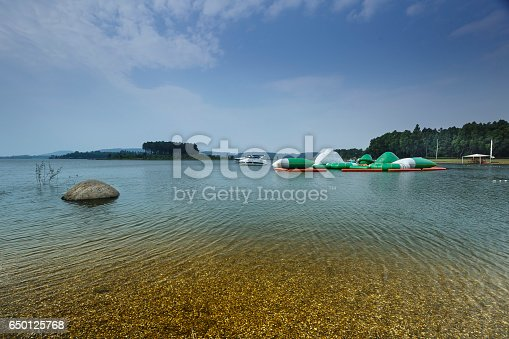 istock lake shore with pebbles and clear water 650125768