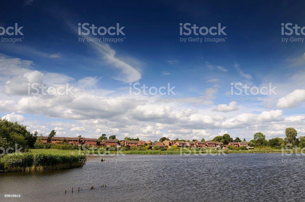 Lake side houses under blue sky royalty-free stock photo