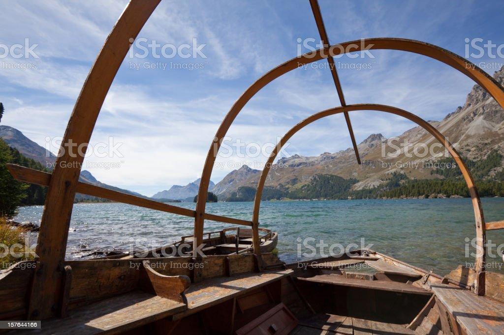 Lake Sils towards Maloja through traditional Boat, Engadine, Switzerland. royalty-free stock photo
