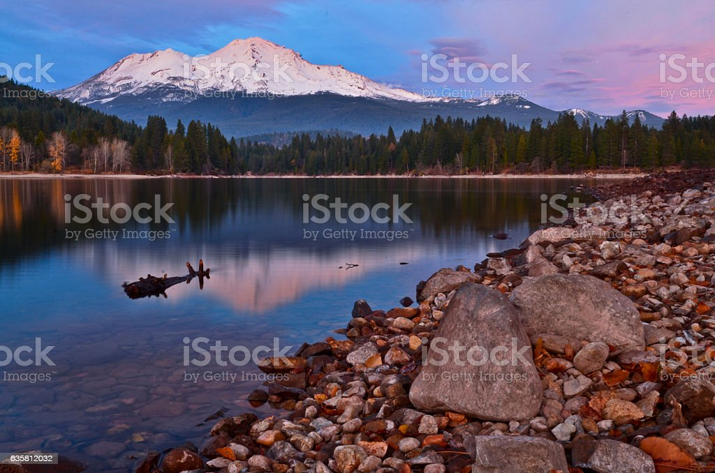 Lake Siskiyou reflecting mount Shasta under beautiful sky after sunset stock photo