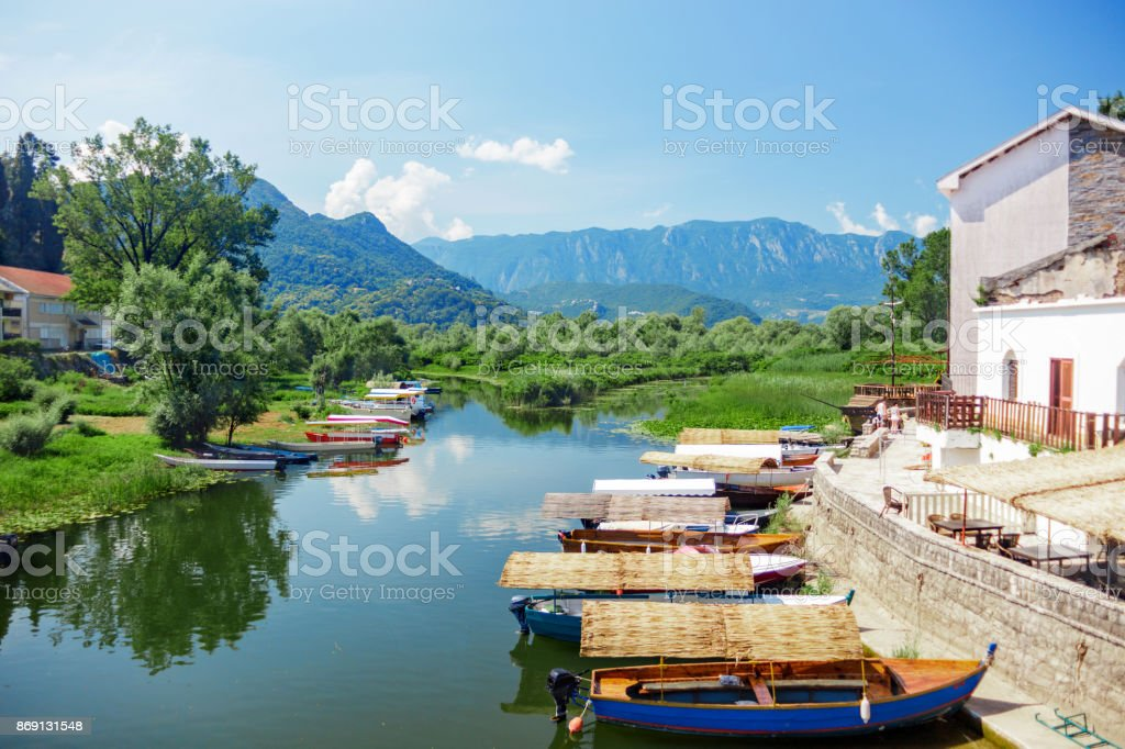 Lake Skadar National Park. Boat with a thatched roof on the pier stock photo