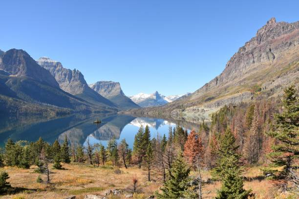 lake st mary reflection - st. mary lake stock pictures, royalty-free photos & images