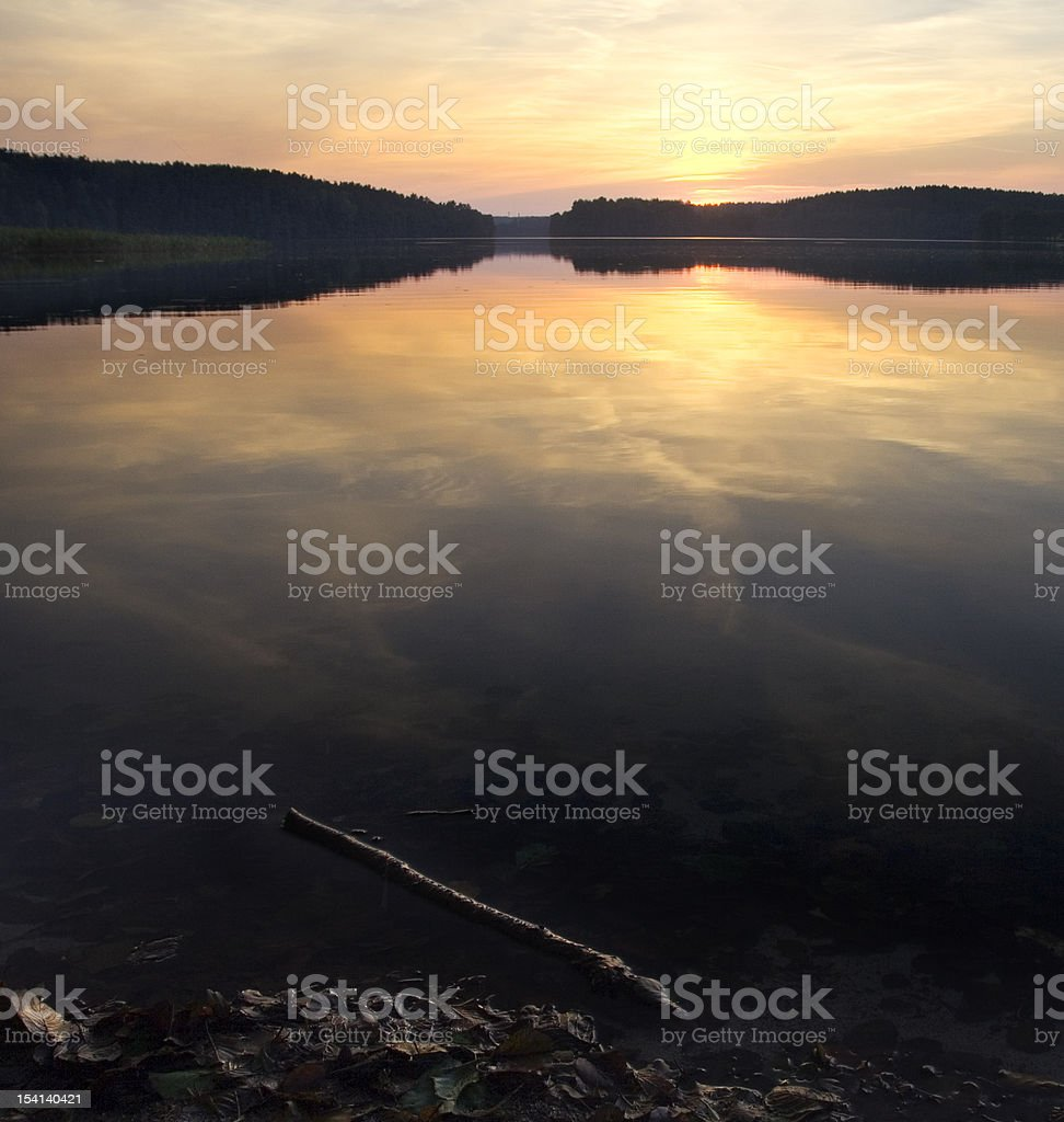 Lake sunset with gold light royalty-free stock photo