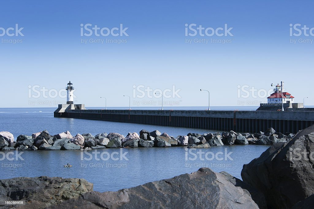 Lake Superior Lighthouse Viewed from Rocky Shore, Duluth, Minnesota stock photo