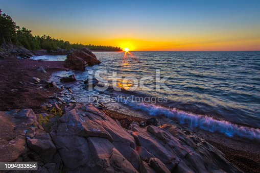 Dusk falls on the rugged shore of Lake Superior in Copper Harbor, Michigan. Copper Harbor is the northernmost point in the state of Michigan.