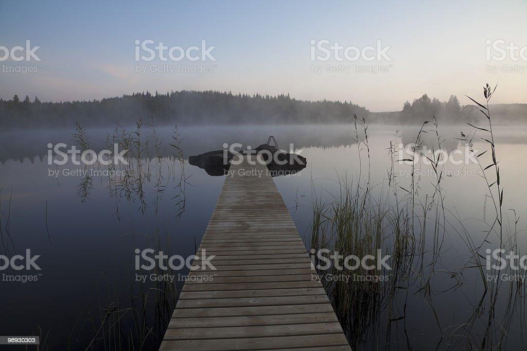 Lake, swim platform and misty morning royalty-free stock photo