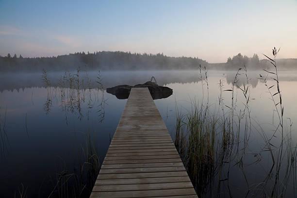 Lake, swim platform and misty morning stock photo