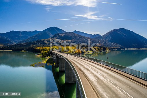 Lake Sylvenstein in Bavaria. Alps Mountains in autumn and beautiful colour of the water. Bridge over Reservoir