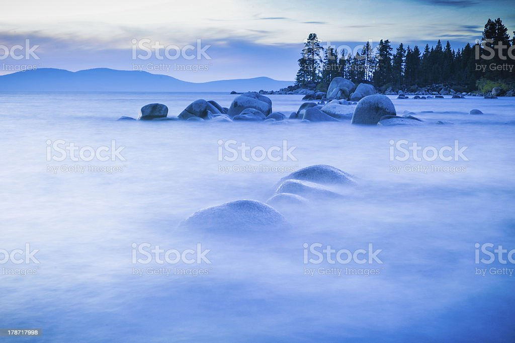 Lake Tahoe boulders appear floating in fog royalty-free stock photo