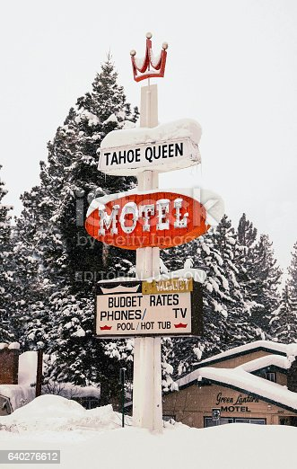 Lake Tahoe, California, USA- December 26, 2012, snow overed vintage motel sign of abandoned motel