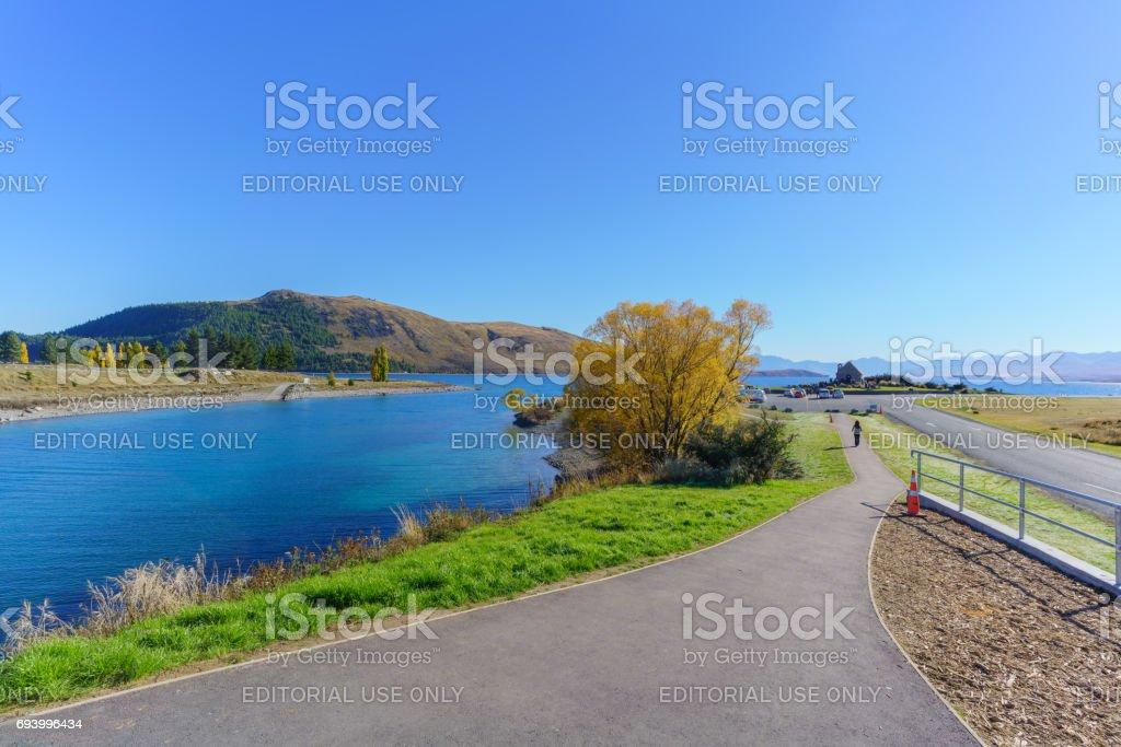 Lake Tekapo , New Zealand - April 22 , 2017 : Atmosphere around Lake Tekapo on Sunday morning in Autumn . People are waiting in front of Church of the Good Shepherd . stock photo