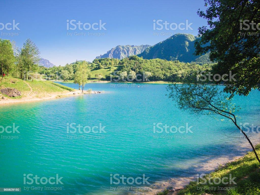 Lake Tenno surrounded by Italian alps. stock photo