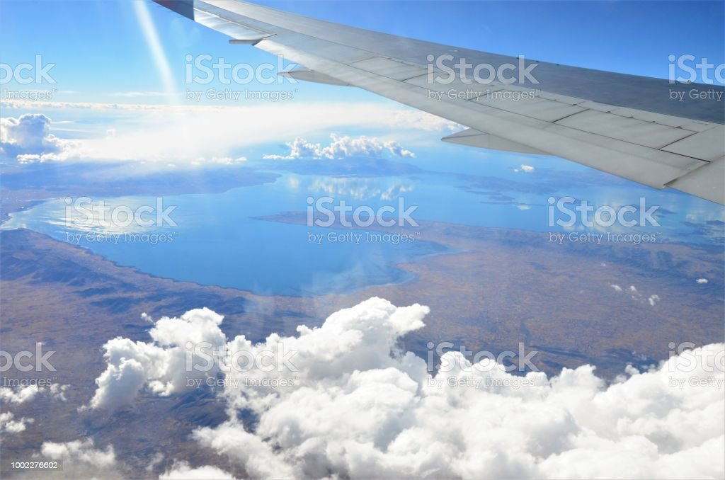 Lake Titicaca viewed from a window high above on a plane. This is the...