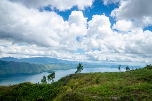Lake toba landscape in tuktuk north sumatra indonesia picture id1137765519?b=1&k=6&m=1137765519&s=612x612&w=0&h=wb9xpku vmnulcwi 2alpabku9wenjmwmctrbs8qcxm=