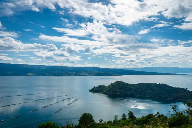 Lake toba landscape in tuktuk north sumattra indonesia picture id1128159834?b=1&k=6&m=1128159834&s=612x612&w=0&h=pjrqgx6bsfczoamvhflmbqpj2tnmgmzi04o9tewwdda=