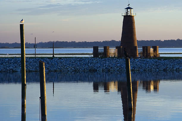 lake toho lighthouse at dawn - kissimmee stock photos and pictures