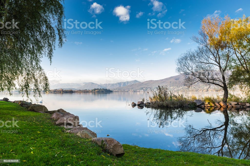 Lake Varese from Cazzago Brabbia, Italy. Nice and quiet sunny day on lake. From left to right: islet Virginia, Biandronno, Gavirate, Campo dei fiori stock photo