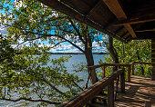 Wooden sauna porch right next to water