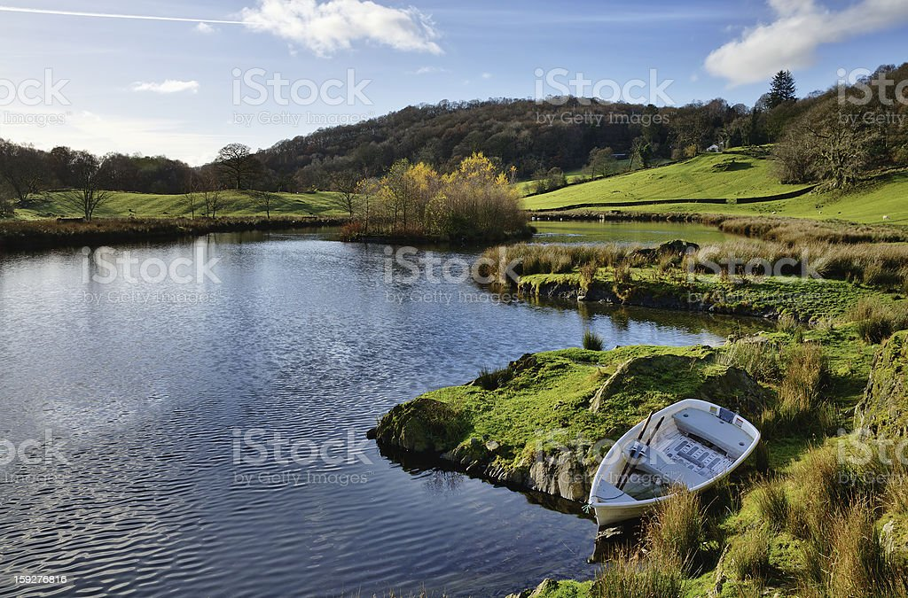 Lake with boat in the Winster Valley, Cumbria. royalty-free stock photo