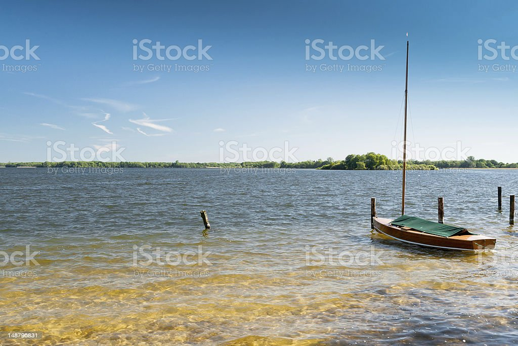 Lake with Boat Lake with Boat Aquatic Sport Stock Photo