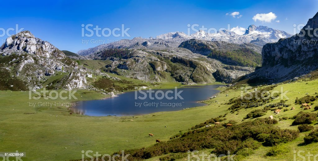 Lake with mountains and clouds stock photo