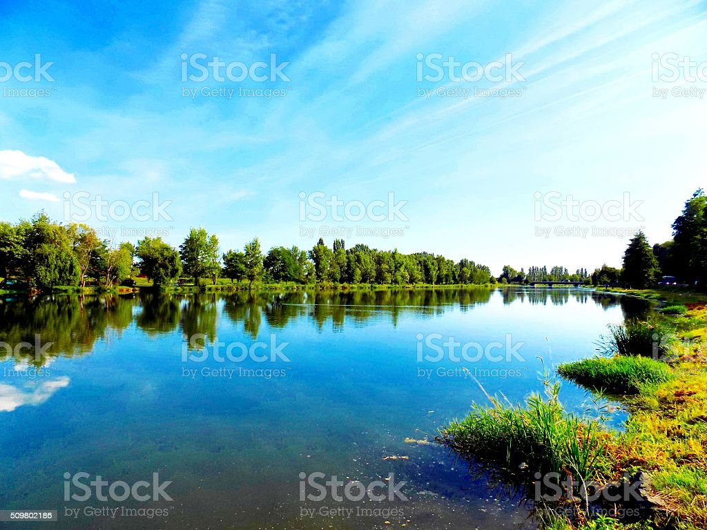 Lake with reflexion, trees and sky stock photo