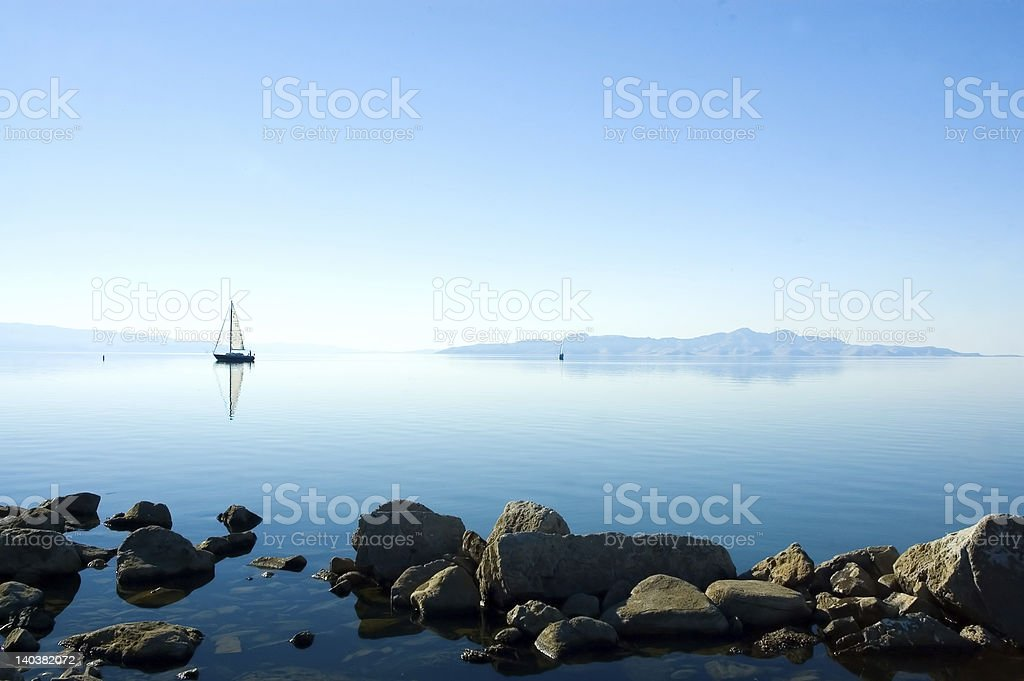 Lake with sailing boat stock photo