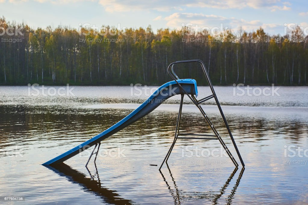 Lake with slide during cold weather royalty-free stock photo