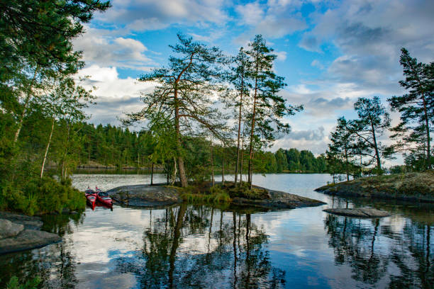 Lake with trees and rocks in the Dalsland Lake District in Sweden.
