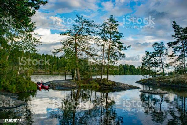Photo of Lake with trees and rocks in the Dalsland Lake District in Sweden.