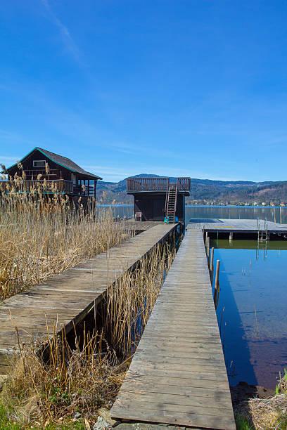 lake woerth jetty - wörthersee stock-fotos und bilder