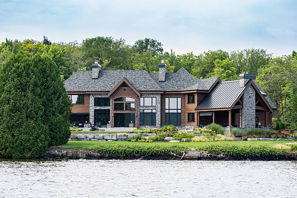 Lakefront Luxury Property on Sunny Day of Summer Lac St-Joseph, Сanada - August 18, 2015: Luxurious lakefront property located in Lac St-Joseph, a rich suburb of Quebec City on a sunny day of summer. promenade stock pictures, royalty-free photos & images