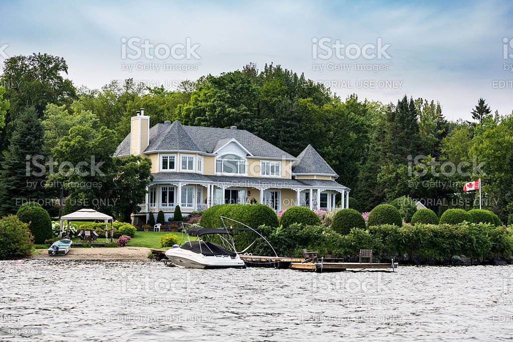 Lakefront Luxury Property on Sunny Day of Summer stock photo