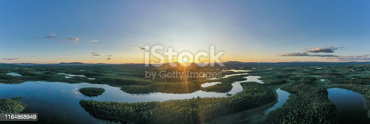 istock Lakes and forests at sunset 1164868949