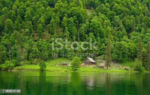 A rustic shelter stands in a quiet glade by the shore of the Königssee, an alpine lake in Germany's southernmost region.