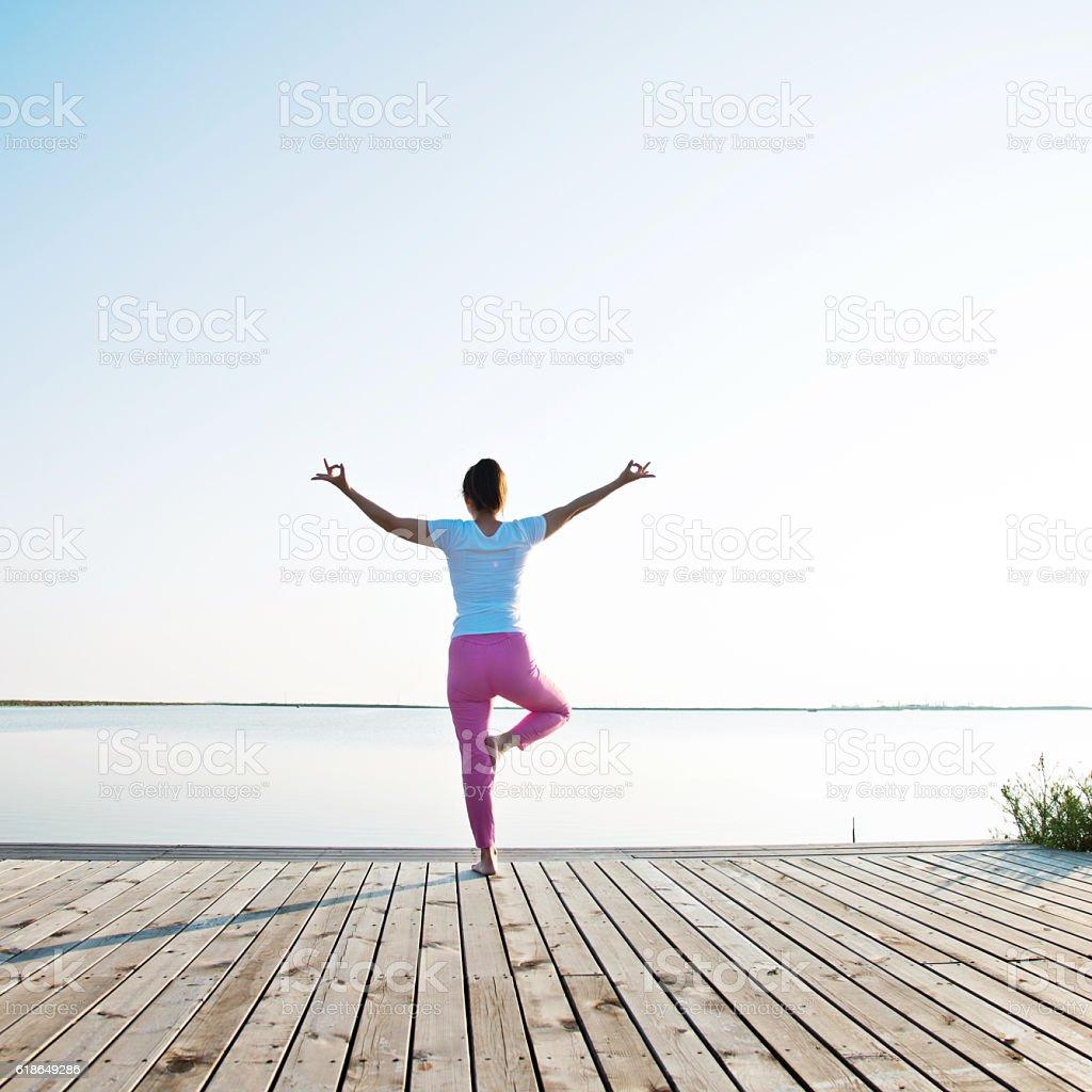 Lakeside meditation stock photo