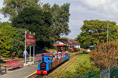 Southport, UK - September 1, 2014: Lakeside Minature Railway, Southport.  A minature steam train can be seen in the station.  People can be seen on the steam train and on the station platform.