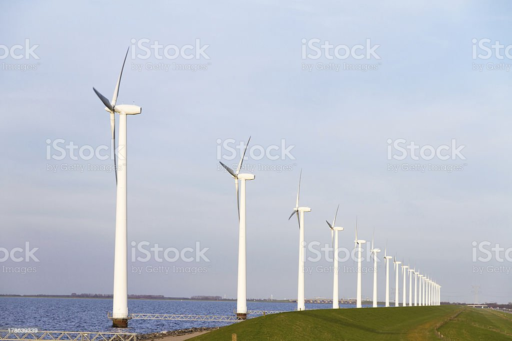 Lakeside wind turbines royalty-free stock photo