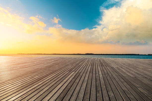Lakeside wood floor platform and sky clouds at sunset. stock photo