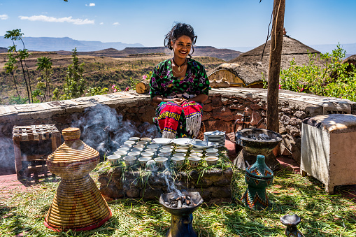 istock Lalibela, Ethiopia: Young woman in traditional clothing is preparing a coffee ceremony. 1216350897