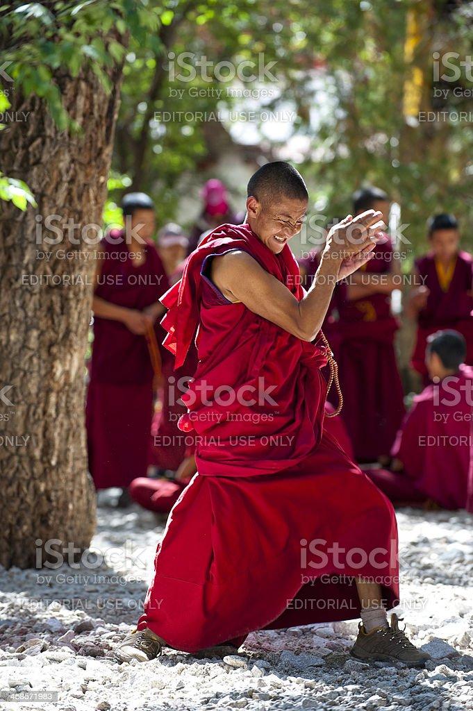 Lama debating on buddhist doctrines stock photo
