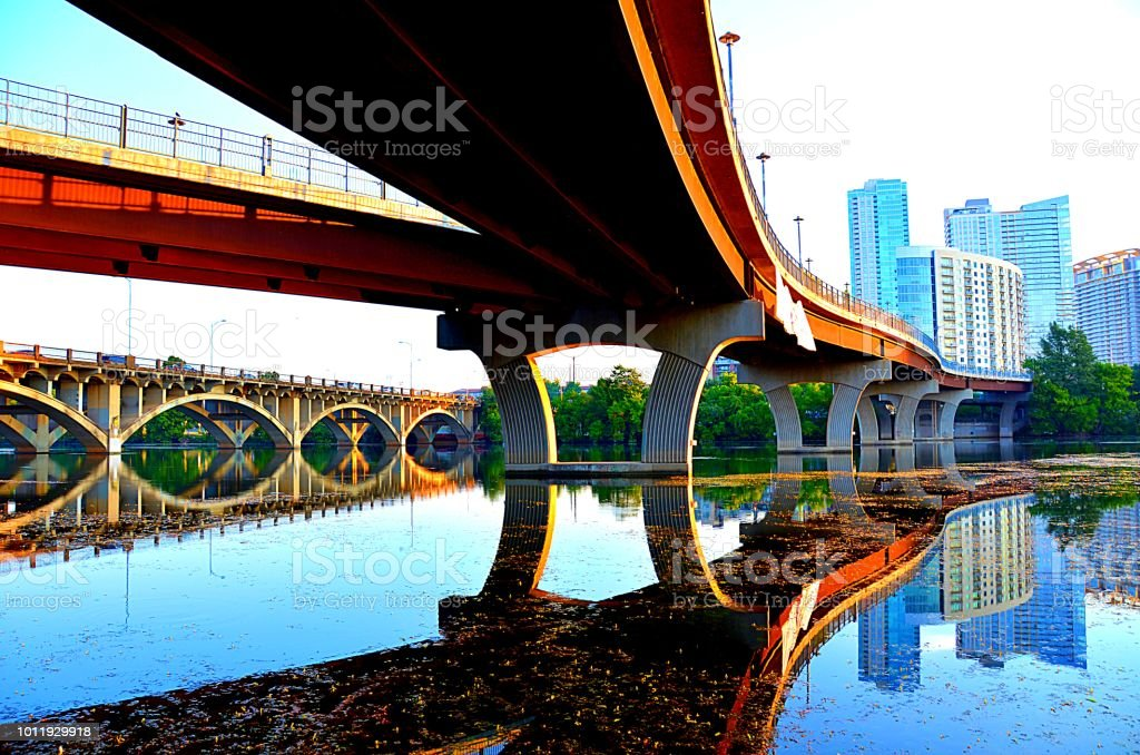 Lamar Boulevard Bridge sunrise reflection in Lake Austin stock photo