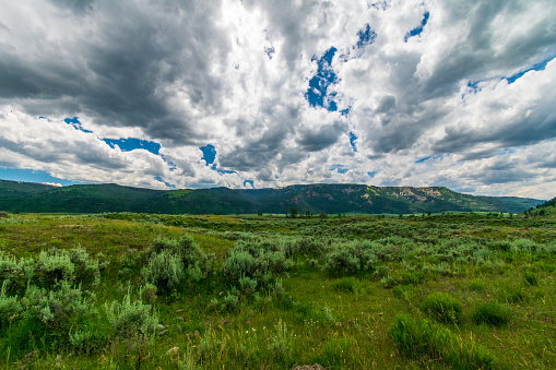 Afternoon clouds roll across Lamar Valley in Yellowstone National Park