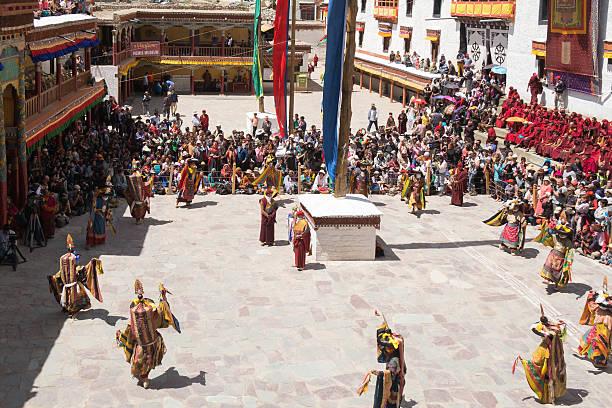 Lamas perform mask dances in Hemis Festival 2014. Leh Ladakh,India - July 7,2014 : Lamas (monks) perform mask dances in Hemis Festival 2014 at Hemis Monastery. annually stock pictures, royalty-free photos & images