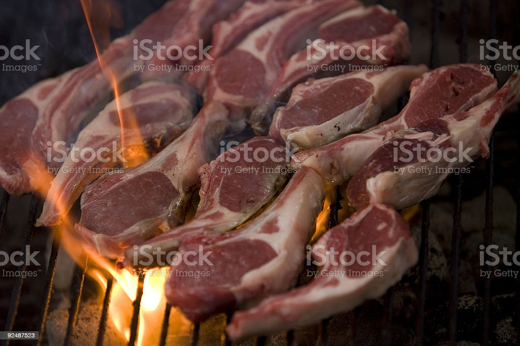 Lamb chops flame grilling royalty-free stock photo