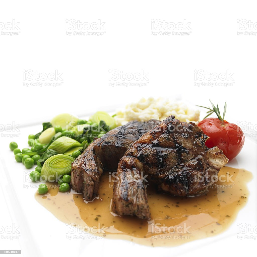 Lamb chops with gravey and vegetables stock photo